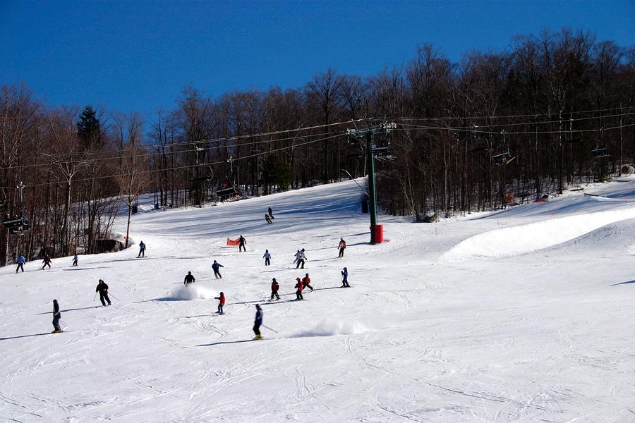 people skiing down ski slopes